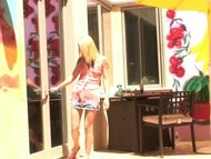 petite blonde gives a blowjob outdoors