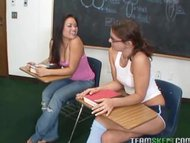 Lovely and horny teen fucking in the classrom with a strapon dildo