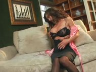 Crissy Moran teases in stockings a garter and heels