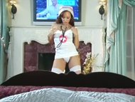 Busty nurse teases in uniform and stockings