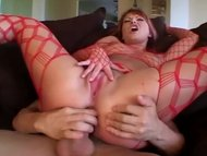 Redhead in fishnet linger...