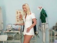 Super sexy blond nurse playing