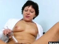 Sexy Milf in nurse uniform stretching hairy pussy
