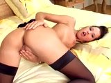 Pretty brunette in a bra panties and stockings