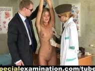 Teen girl during rough army medical examination