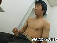 Japanese Stud Rubbing His Stiff Cock
