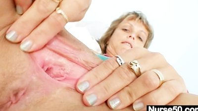 Skinny milf senior nurse toys her pussy on gynochair