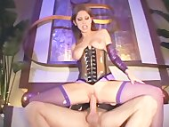 Brunette fucks in a shiny...