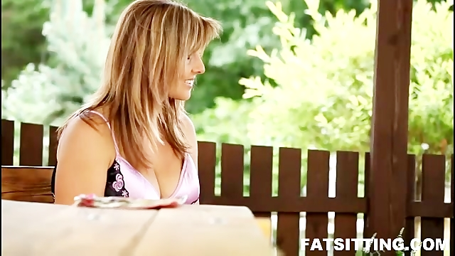 Busty mature bitch facesitting a male slave on the table top