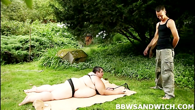 Chubby redhead and SBBW bitch torture guy in the park in BBW femdom orgy