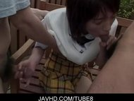 Japanese teen babe gagging and stroking two hard cocks in public
