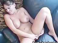 Busty babe Leslie masturbating on the couch