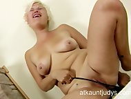 Milf Kelly plays with her...