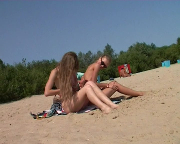 Naked teen nudist lets the water kiss her body