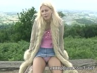 Outdoor blonde flashes tits an