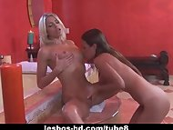 Hot lesbian couple in act...