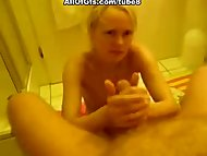 Blond girl blows cock in bathr