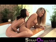 StrapOn Hot hispanic babe fucked in hot tub by lesbian with black dildo