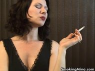 MILF Mina puffs on a cigarette