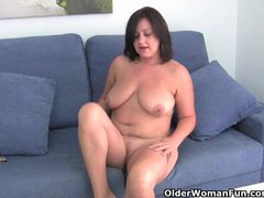Mature mom with big tits pinches her nipples and rubs her clit
