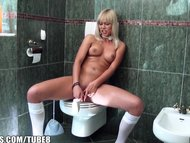 Blonde with bangs bangs her self