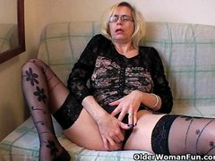 Tube8: Perverted granny pushes her fist up her old cunt