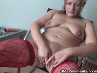 Mature mom in kinky outfit rubs her clit and toys her pussy