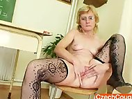 Dame teacher masturbates herself after a class