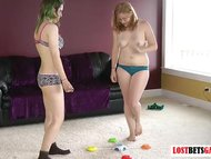 Two babes play a game of ...