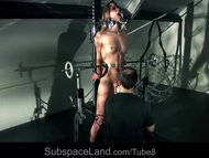 Sexy redhead slave girl screaming of pain and pleasure in bdsm session