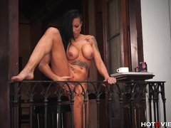 Public Brunette Solo video: Stretching and Squirting off her Balcony