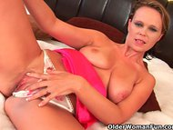 Busty soccer mom sucks cock an