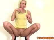 Solo blonde pissing while masturbating