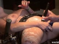 Hot wax fetish with a restrained sex slave
