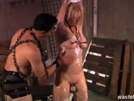 Blonde suspended and wrapped in clingfilm for flogging