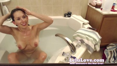 Webcam girl washes hair and shaves legs and pussy in bath