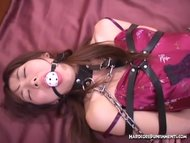 Ball gagged and wrapped in chains for BDSM orgasms