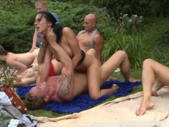 Blonde Blowjob Brunette video: Hardcore Group Garden Orgy