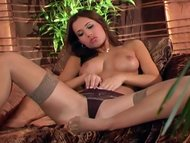 Pretty model fingering in thigh high stockings