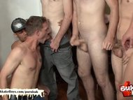 Bukkake boy takes two cocks up his ass