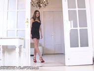 Perfect bodied brunette beauty fingering her tight pussy in the doorway