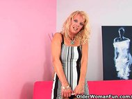 Over 50 mom in stockings probes herself with a big dildo