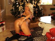 Hot and horny girl dolled up for Christmas masturbates by the tree