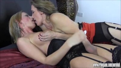 Blonde shemale wanks big cock as busty Milf teases her nipples and balls