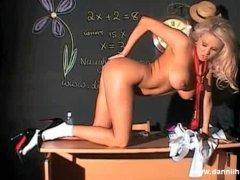 Slutty blonde schoolgirl Dannii oils up her lovely big tits