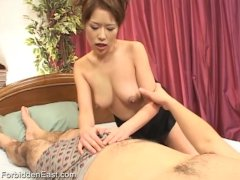 Japanese women is finger fucked to a screaming orgasm
