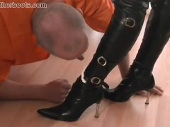 Dirty pathetic slave licks cream off two leather clad femdoms boots