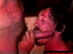 Hairy dirty redneck giving blowjob to mature bear