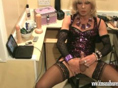 Sexy blonde crossdresser fingers her ass and wanks her smooth hard cock