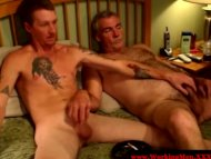 Smoking gay couple tuggin...